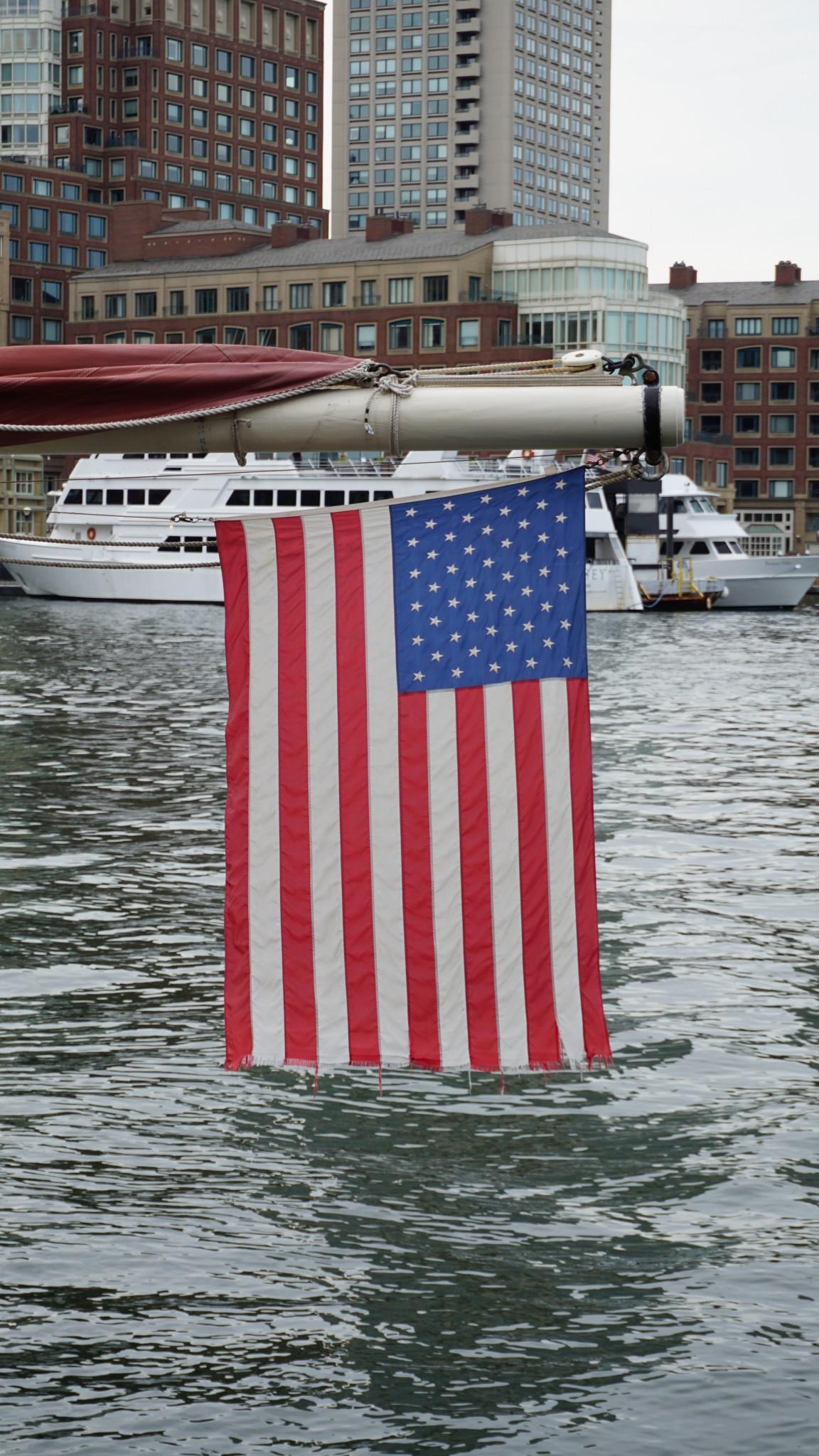 american flag boston harbor, the-alyst.com